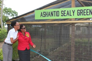 Ashantio's sister Shari Grant (left) and Principal Donna Allman were excited as they unveiled the new name.