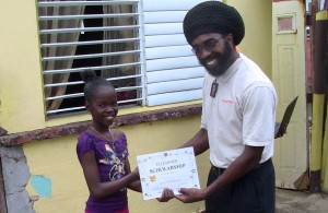 Shanai Henry receiving her prize from ezLearner CEO, Troy Weekes.