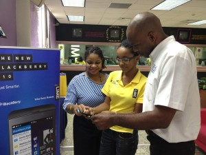 LIME customer service representative Danille Springer, showing customers the features of the latest BlackBerry device the BlackBerry Q10.