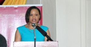 Managing Director of CIBC First Caribbean International Bank, Donna Wellington, addresses the launch of the bank's Medical Professional Edge scheme at St Ann's Fort, Garrison, St Michael.