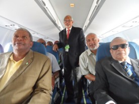 Prime Minister Baldwin Spencer, LIAT CEO Ian Brunton, Chairman Jean Holder and Tourism Minister John Maginley get comfortable in the new LIAT aircraft.