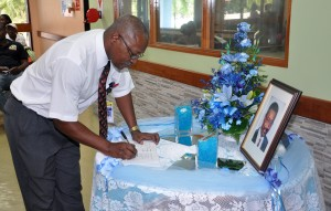 Acting director of Medical Services signs the condolence book today.