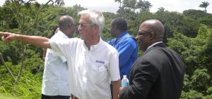 Sir Charles Williams gestures during today's tour with Minister Lowe.
