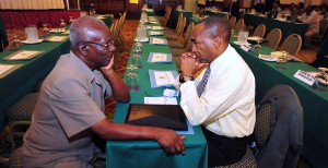 Sir Roy Trotman (left) and Darcy Boyce in deep conversation.