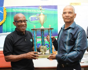 BFA president Randy Harris (left) and the NSC's Adrian Donovan show off the Bico Primary Schools Football trophy.