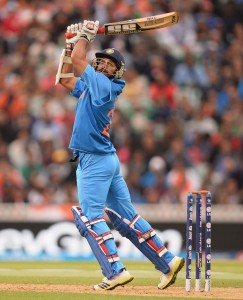Century-making Shikhar Dhawan smashing a six over third man.