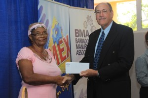 Wilma Springer gets her airline ticket from BMA President David Foster this morning.
