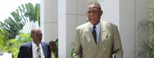 """Sir Richard Cheltenham (right) legal counsel for residents of Cane Garden, St.Thomas, where B's Recycling plant is located, says the home owners want the company to stop operating """"unregulated"""" in their district and causing them health problems. At left is retired Appeal Court Justice, John Connell, one of those filing an injunction in court today to shut down the operation."""
