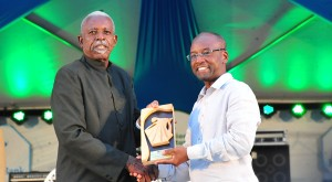 Anthony Walrond (left) receives his award from Minister of Culture Stephen Lashley.