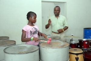 Mikel gets a little steelpan direction from her musical dad Wayne Gooding.