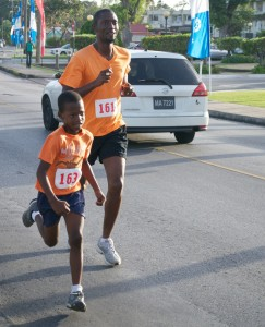 One of the youngest Runners Shakiel Anderson with Maurice Anderson.