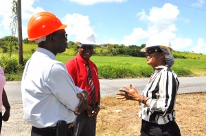 Minister of Labour, Senator Dr. Esther Byer Suckoo (right) discussing the demonstration with Deputy Chief Labour Officer, Victor Felix and Managing Director of the Barbados Light & Power, Mark King (left).