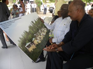 Minister Ronald Jones and Sir Hilary Beckles look over artist impression of new park.