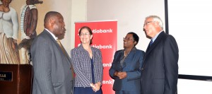 Minister Donville Inniss with Scotibank's Lisa Cole, Alison Saunders-Franklyn and David Neiland.