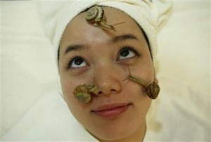 Snails crawl on the face of a woman during a demonstration of a new beauty treatment at Clinical-Salon Ci:z.Labo in central Tokyo