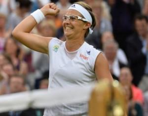 Belgian Kirsten Flipkens celebrates reaching her first Grand Slam semi- final at age 27