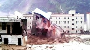 A building collapsing due to the mudslide.