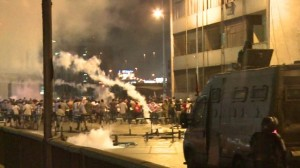 Protesters being sprayed with tear gas.