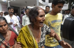An Indian woman mourns the loss of her grandchild.