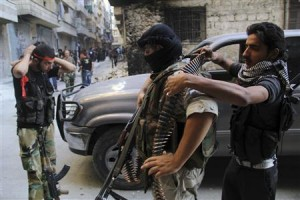 """Free Syrian Army fighters prepare for an offensive against forces loyal to Syria""""s President Bashar al-Assad, in Aleppo""""s Salaheddine neighborhood."""