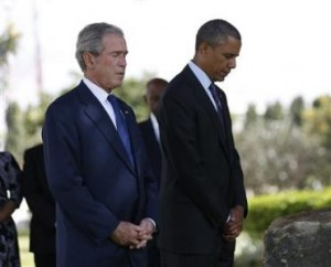 U.S. President Obama and former President Bush attend a memorial for the victims of the U.S. Embassy bombing in Dar es Salaam