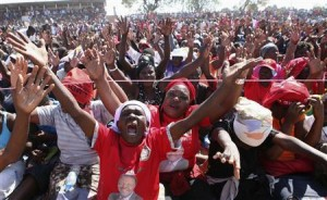 Supporters cheer as Zimbabwe's opposition MDC leader Morgan Tsvangirai addresses a campaign rally in Chitungwiza, about 30 km (19 miles) south of Harare