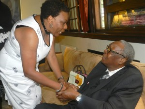 Pastor Laurel Scott greeting Sir Lloyd.