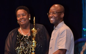 Minister of Culture Stephen Lashley (right) presented veteran bandleader Gwyneth Squires with the Robert Weekes Award for Festival Designer of the Year.