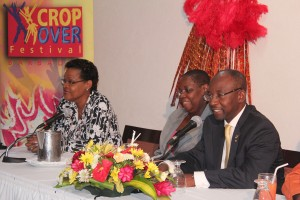 Minister Lashley (right) at the head table with his Permanent Secretary Ruth Blackman (middle) and the sponsors' representative Margaret Allman-Goddard.