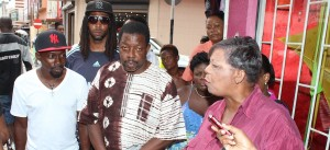 BLP's Cynthia Forde (right) speaking while BARVEN President Alister Alexander (centre) and other vendors listen.