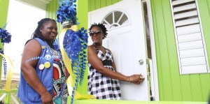 President of Kiwanis Club Barbados Central Marilyn Patrick (left) smiling as Gail Browne turns the keys to her new home.