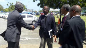 Prime Minister Stuart is welcomed by Anglican Church leaders.