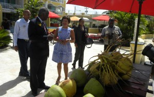 The Prime Minister pauses here during tour, probably with a cooling drink of coconut water in mind.