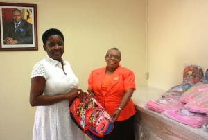 Left to Right: Meshell Rawlins presenting bags to Denise Nurse of the Child Care Board.