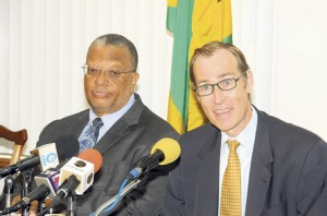 Head of the International Monetary Fund's staff review team Jan Kees Martijn (right) addresses yesterday's press conference at the Ministry of Finance and Planning in Kingston, while Finance Minister Dr Peter Phillips listens.