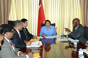 Prime Minister Kamla Persad- Bissessar, centre, speaks with Opposition Leader Dr Keith Rowley, right, during a discussion on crime at the Diplomatic Centre, St Ann's, yesterday. Looking on, from left, are Clifton De Coteau, Minister of National Diversity and Social Integration; Attorney General Anand Ramlogan; and Legal Affairs Minister Prakash Ramadhar