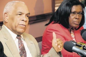 Transport Minister Dr Omar Davies addressing a press conference to announce a 25 per cent increase in bus and taxi fares at the ministry's Maxfield Avenue offices in Kingston yesterday. Also pictured is permanent secretary in the transport ministry Audrey Sewell.