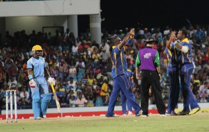 The Barbados Tridents celebrate the fall of a St. Lucia Zouks wicket.