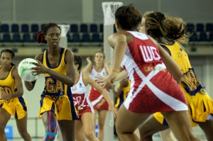 Barbados' goal-attack Shannon Hackett (with ball) is about to make a pass during today's game against England. (Picture by Tom Roberts)