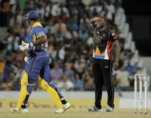 Fast bowling soldier Sheldon Cotterrell (right) sees off another batsman.