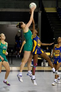 Tonisha Rock-Yaw is almost dwarfed by the Aussie player while team-mate Shanice Rock (right) looks on.