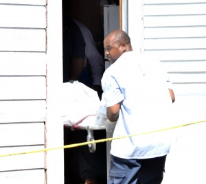 The body of Shavonne King being removed from her home.
