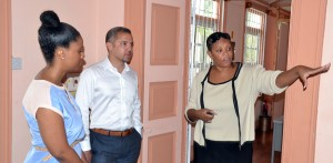 AT RIGHT - CEO of the Centre, Sharonne Taitt showing Verus International's Dirk Hall's and his wife Nerissa Holder-Hall the Challenor School.