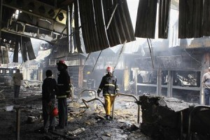 Fire fighters inspect damages from fire at Jomo Kenyatta International Airport in Nairobi
