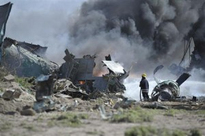 AMISOM firefighter attempts to extinguish fire at site of an airplane crash in Mogadishu