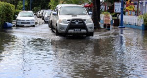 These vehicles make their way through the flooded St. Lawrence Gap, Christ Church.