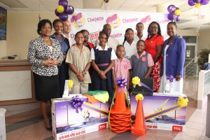 Chefette officials posing with principals and students at the presentation.
