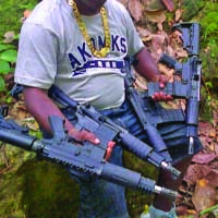 Gang member showing off his weapons