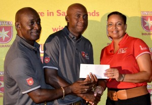 Chris Richards (centre), winner of the Professional Tournament of the 2013 United Insurance Barbados Golf Open, accepts his cash prize from Sharron Alleyne-Elcock of United Insurance and BGA President Hadley Byer.