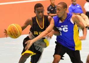 Nikolai Burton (with ball) was among several youngsters who impressed at the Mini-League Basketball Classic. (FP)